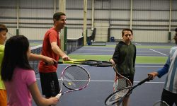 Rackets during junior tennis clinic